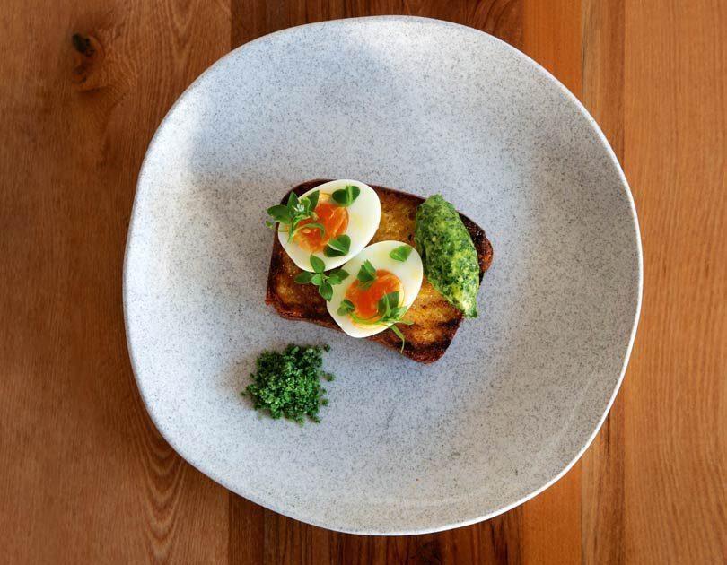 BOILED DUCK EGG ON BRIOCHE WITH HERB BUTTER & HERB SALT