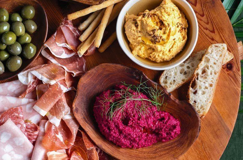 Antipasto Platter with Roast-Cumin Kumara Hummus & Baby Beetroot Hummus