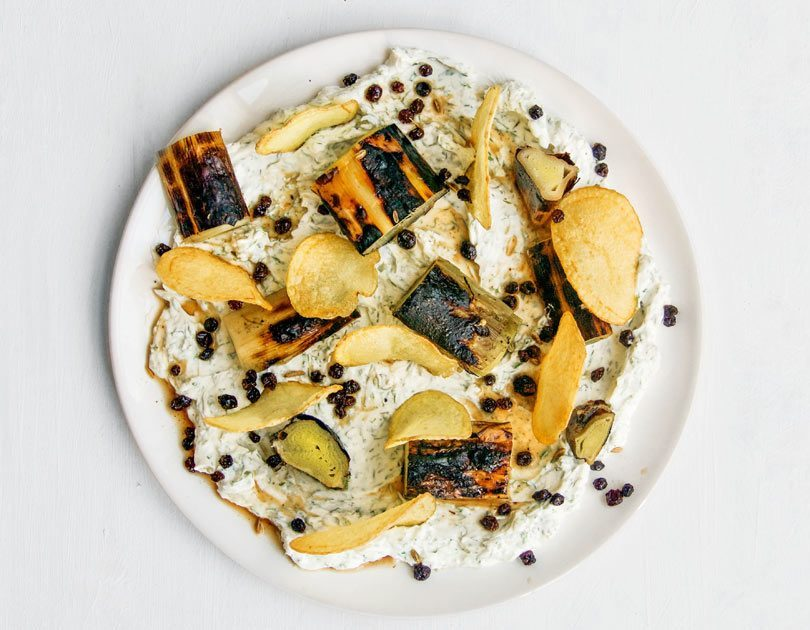 Braised, Charred Leeks, Dill Labneh, Potato Crisps & Pickled Currants