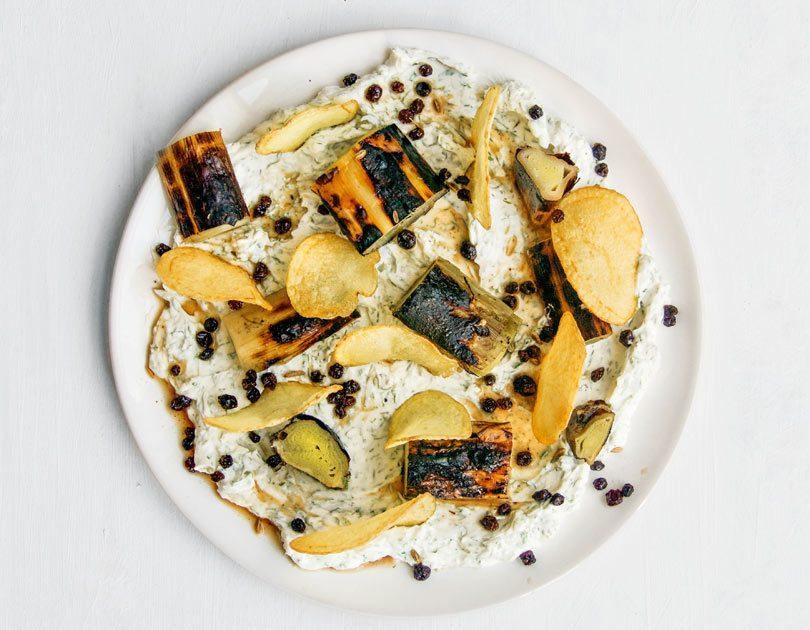 Braised, Charred Leeks, Dill Labneh, Potato Crisps & Pickled Currants