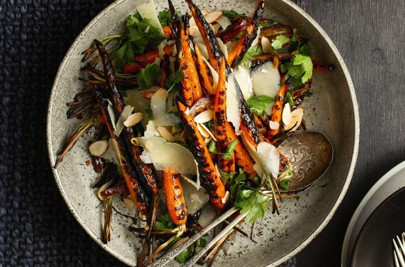 CHARRED CARROTS WITH DATES, TOASTED ALMONDS, PARMESAN & LEMON DRESSING