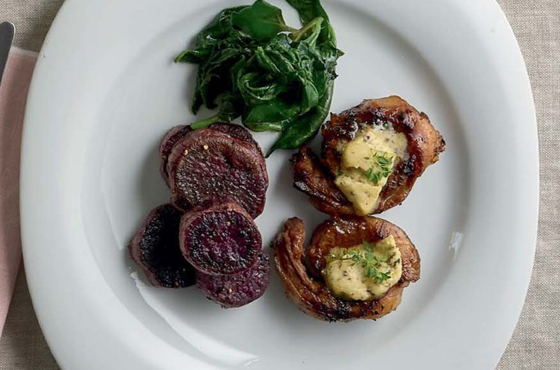 NOISETTES OF LAMB WITH HONEY & HERB BUTTER, KŪMARA DISCS & WILTED GREENS