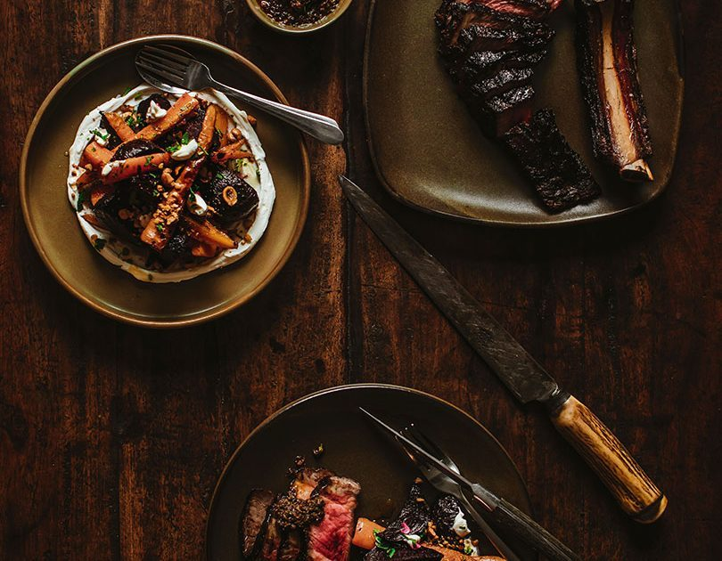 GRILLED BONE-IN RIBEYE WITH ROASTED BEETS & CARROTS